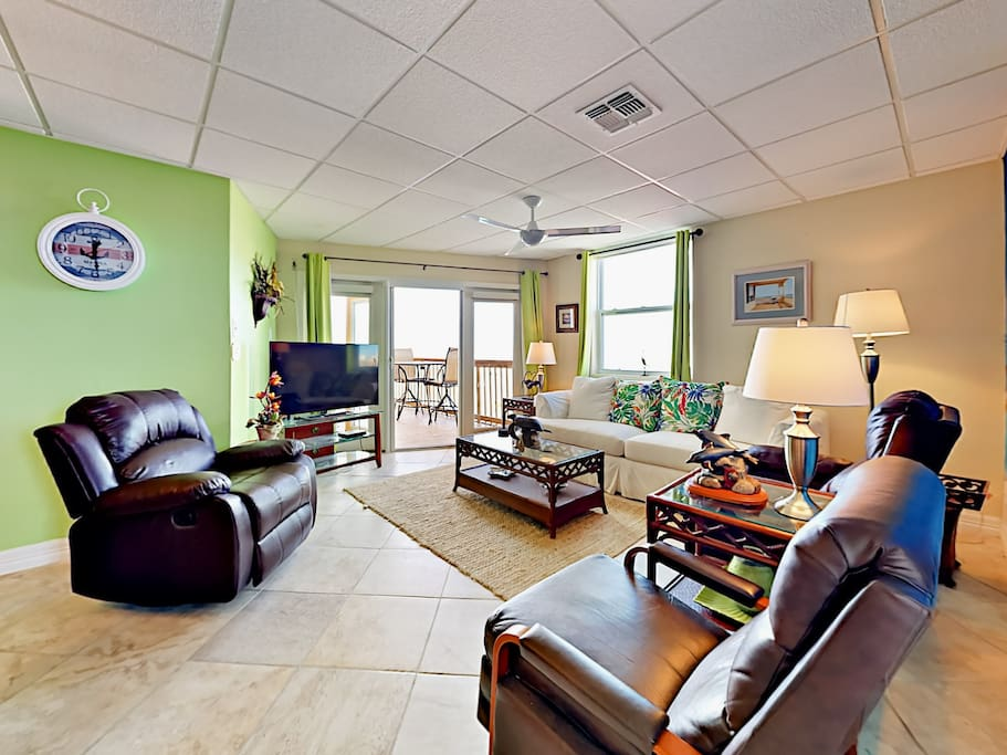 This condo features bright decor that accentuates the rich furnishings throughout.