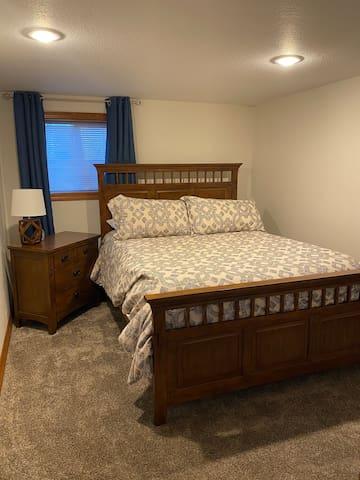 Basement bedroom 1 with queen bed