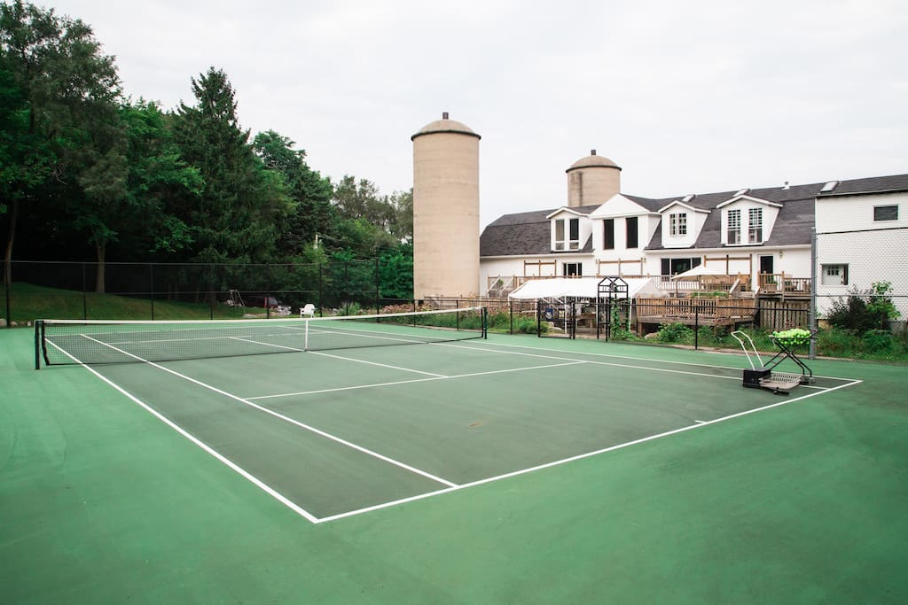 Tennis court, fire pit, hot tub, three decks on two acres.