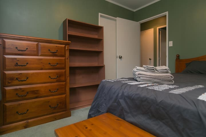 Queen bedroom with drawers and closet space