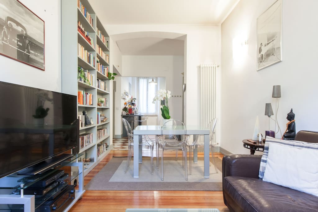 Bright and spacious living room with balcony and wooden floor