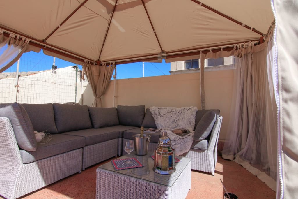 enjoy coffee in the shadow or a drink in the evening. Gazebo with mosquito nets.