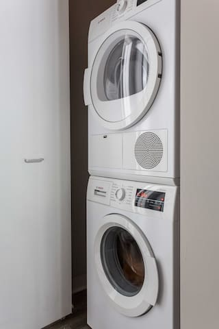 Washer/dryer with detergent provided for your laundry needs.