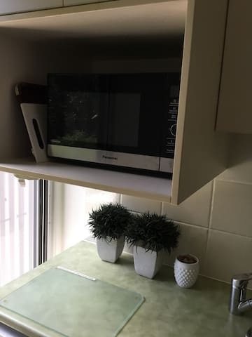Microwave above washing machine