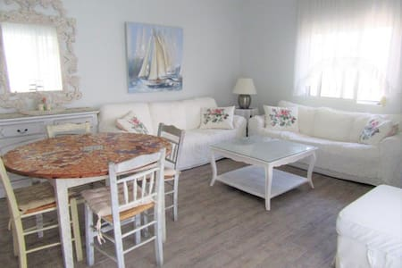 Pefkochori apartment with yard and indoor parking.