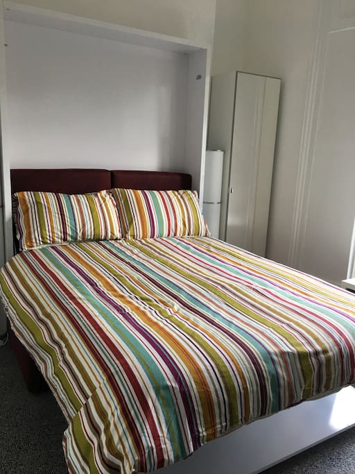 Double bed shown folded down over sofa