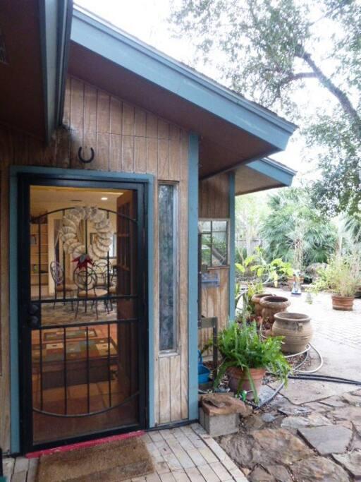 Front door leads to patio/living room