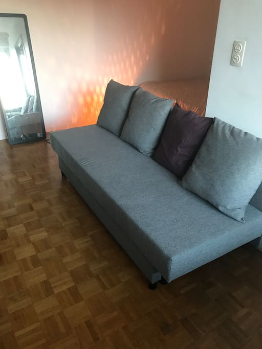 Comfortable couch towards the Tv