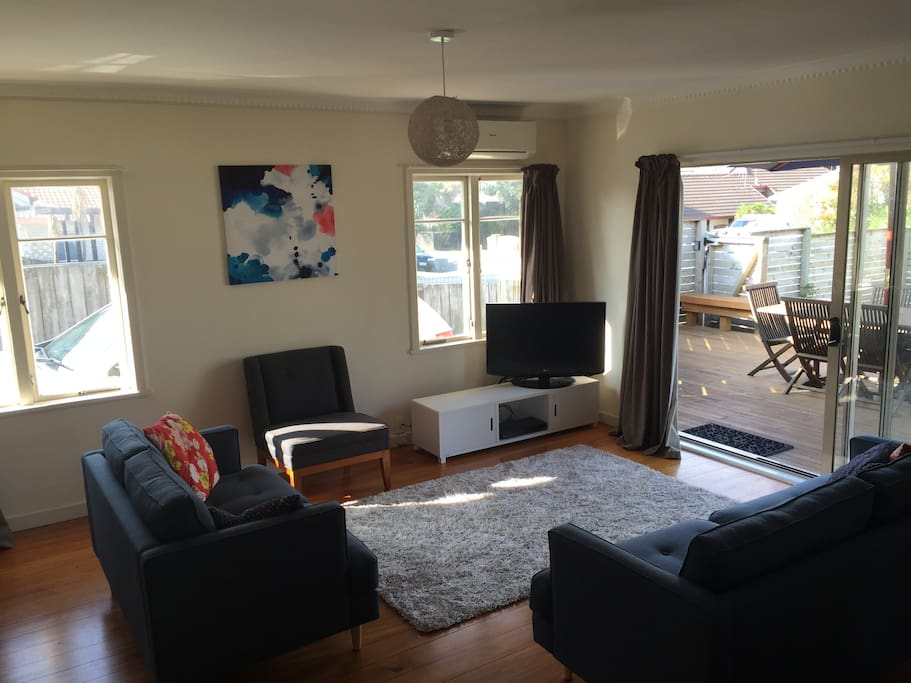 Lovely living room with TV, DVD and Outdoor flow to deck.