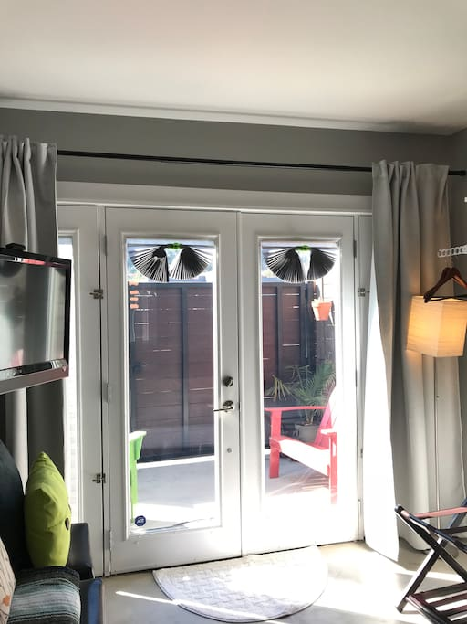 Double-paned French doors let in lots of light, but reduce noise and heat, and open to your private patio.