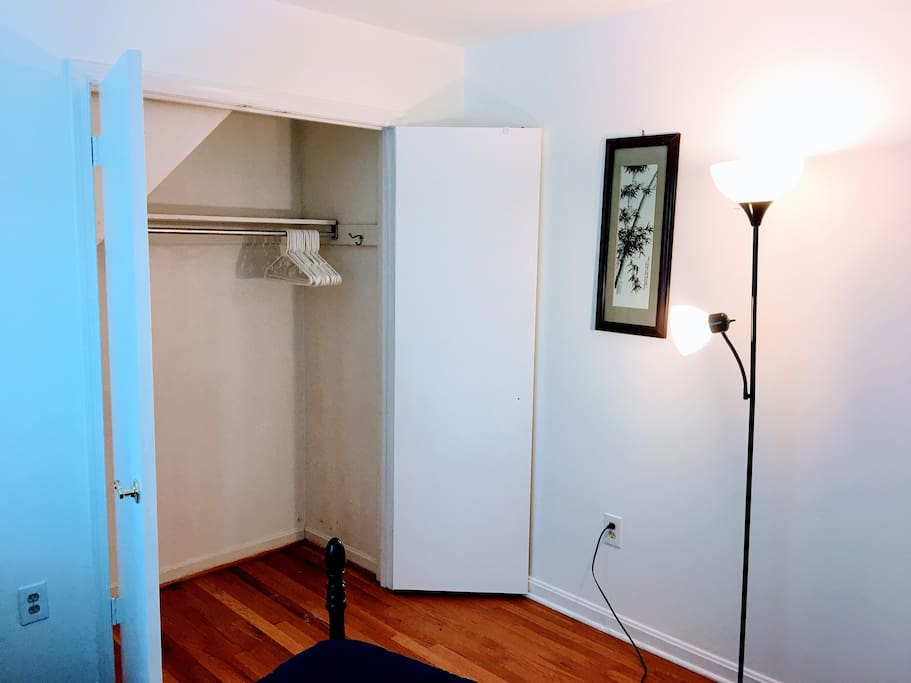 Spacious Closet with Floor Lamp.