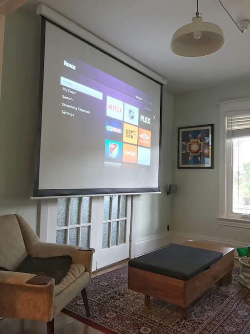 Living room and projector screen, Apple TV and WiiU