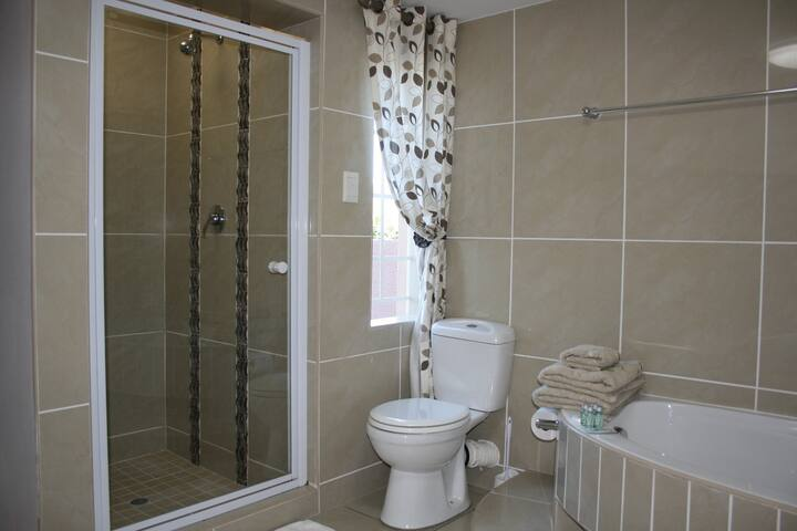 Shower and bath in spacious bathroom
