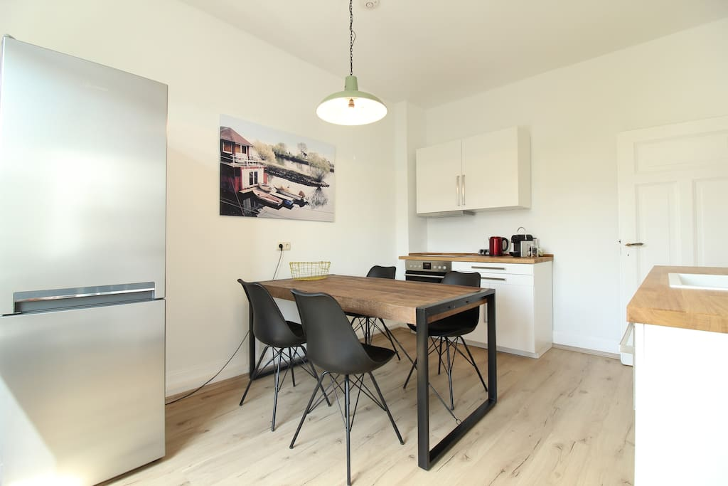 The modern kitchen is fully equipped & very bright.