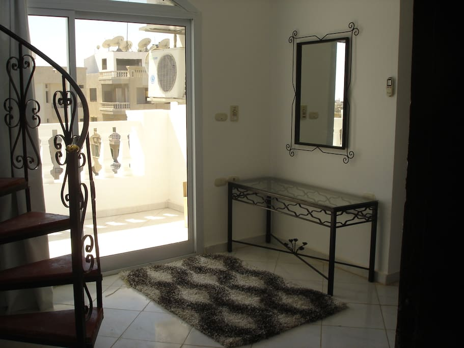 Entrance lobby, with Patio doors leading to large South facing balcony.
