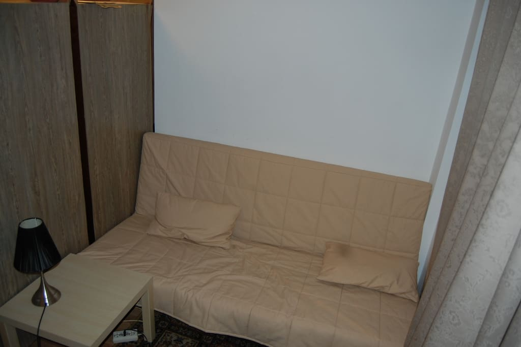 2nd couch/futon - can be made into a double bed