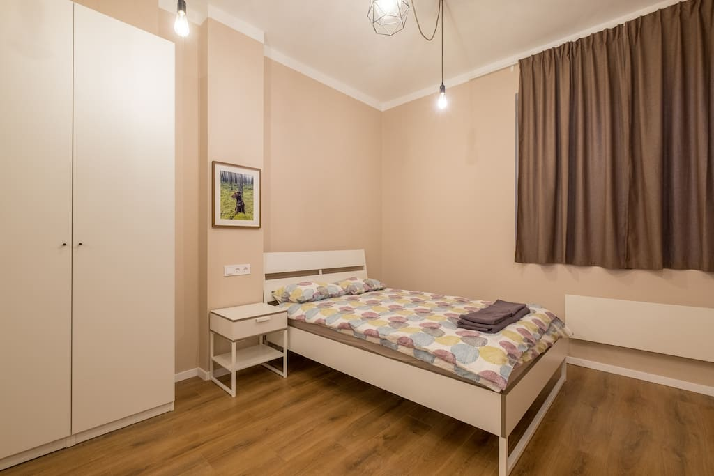 Comfortable double bed and storage