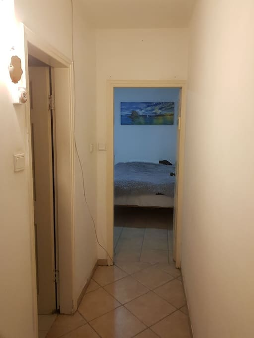 The entrance to the bedroom is directly, private bathroom is on the left side