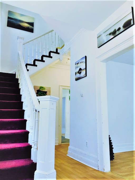 Foyer/main entrance staircase leading to second floor.