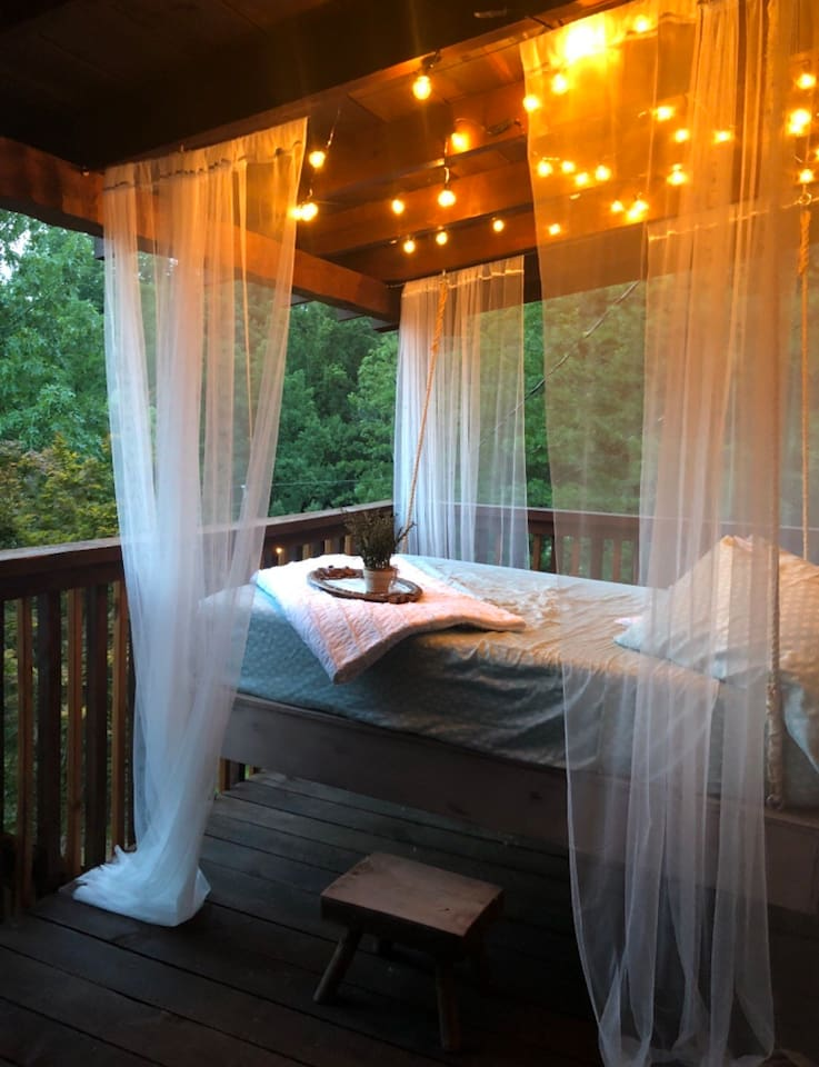 Full-sized, private, outdoor hanging bed with Mountain View.