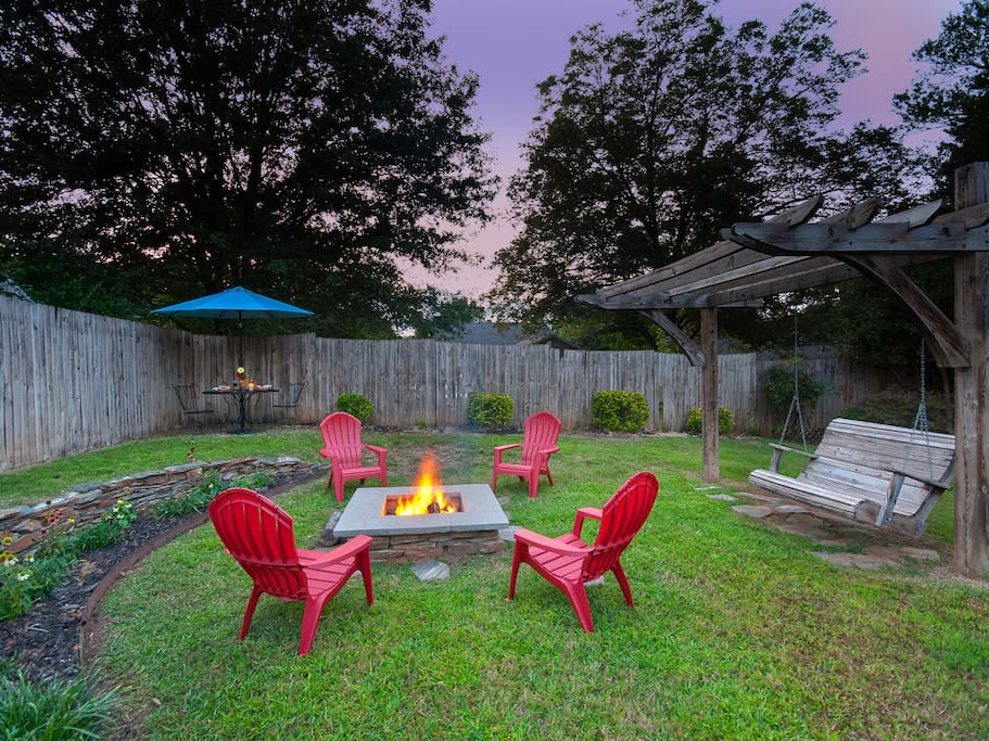 After a long day, relax around the fire pit or swing away your stress in our backyard paradise.