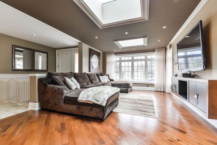 comfortable master bedroom with large bathroom