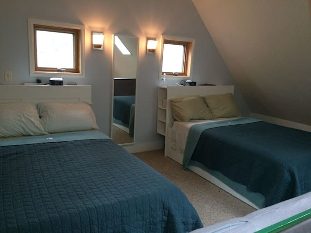Two full size beds in open loft include storage and extra sheets. Need to climb a spiral staircase to access loft. Loft is open and it overlooks the living room.