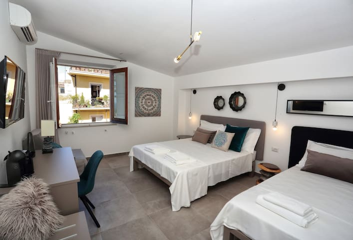 Modern and Spacious Triple Room with a Nice View of the Sea and the Etna Volcano.