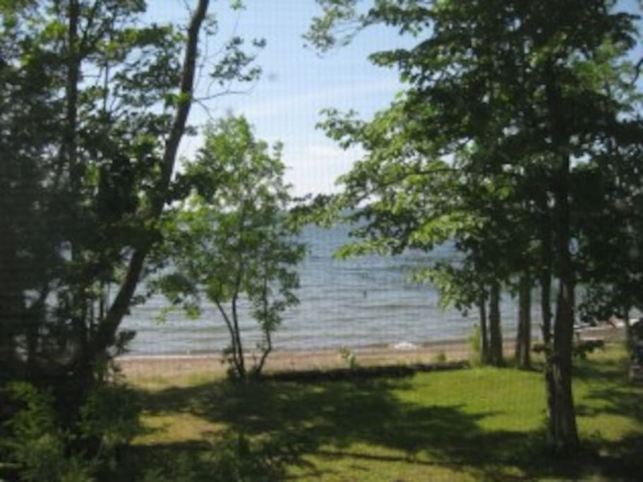 View from the front porch.  Lake is shallow and beach sandy.  Perfect for families with young children