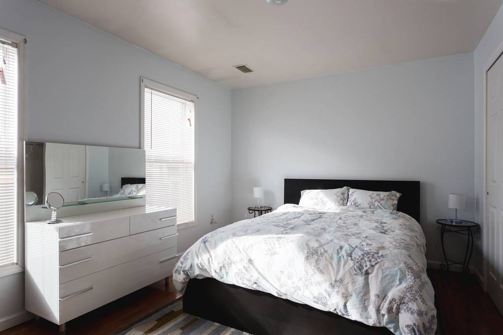 Master bedroom with private full bathroom. Includes 2 closets, 2 drawers, and a study desk.