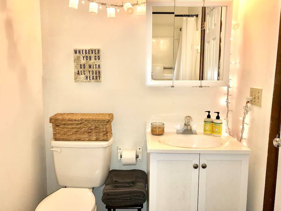 Bathroom with full shower, and basic toiletries provided.