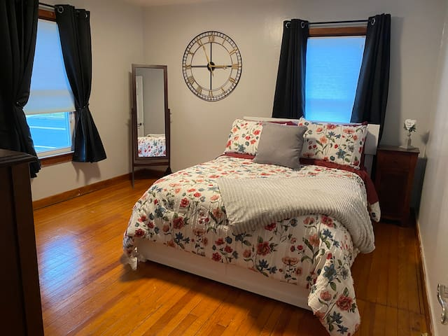 Full bed in quiet bedroom with simply cozy decor.  Extra blankets, iron/board in large closet for your convenience.