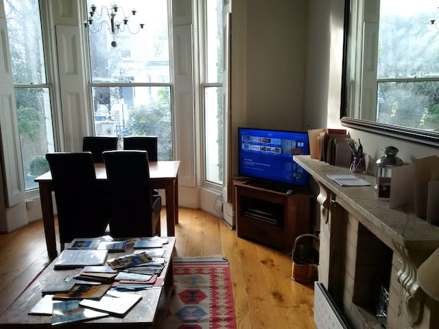 Dining area in sitting room with satellite digital HDTVSky