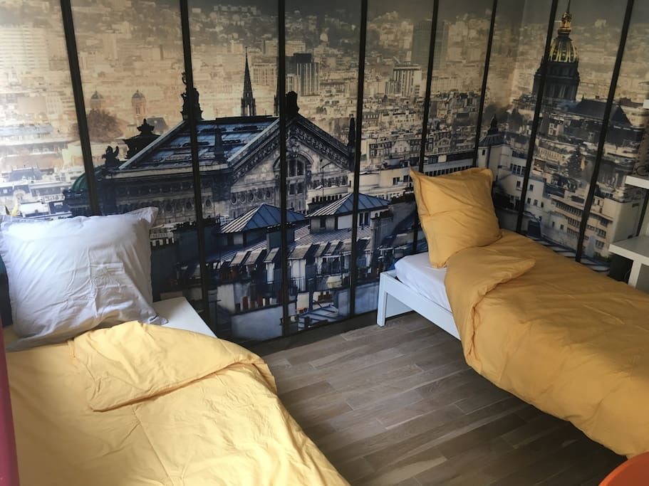Your room, when the 2 beds are open. Mattress and sheets are new, high quality sleeping