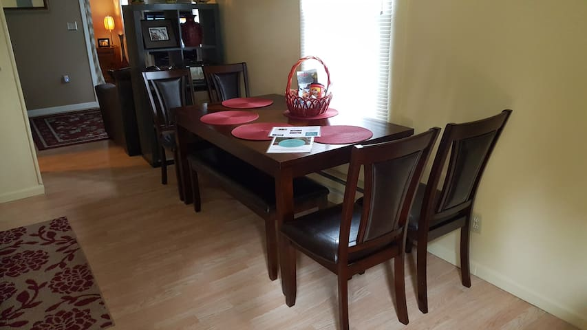 Brand new large dining room table with 4 chairs and a table long bench. Welcome basket and home information on table.