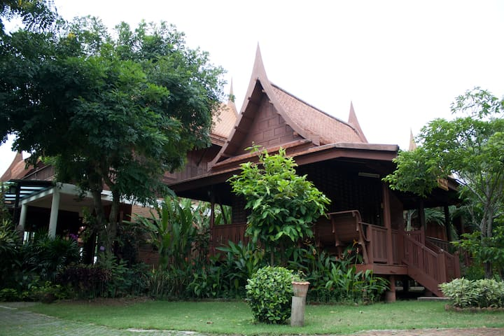 The teak wood Thai house by river