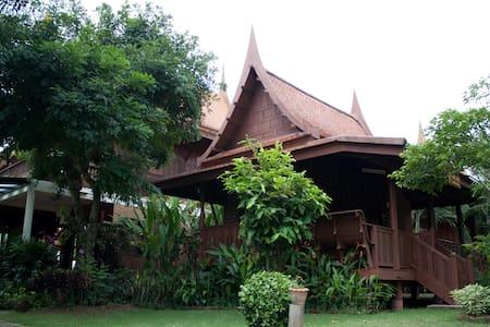 The teak wood Thai house by river - Phra Nakhon Si Ayutthaya