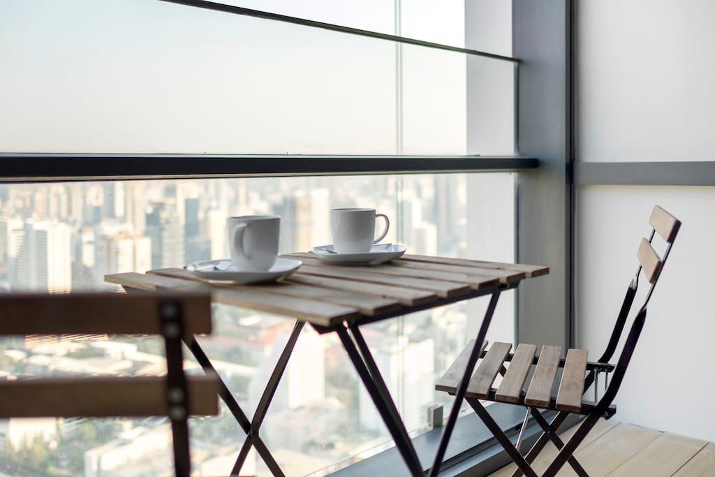 Having breakfast on the balcony watching the sunrise