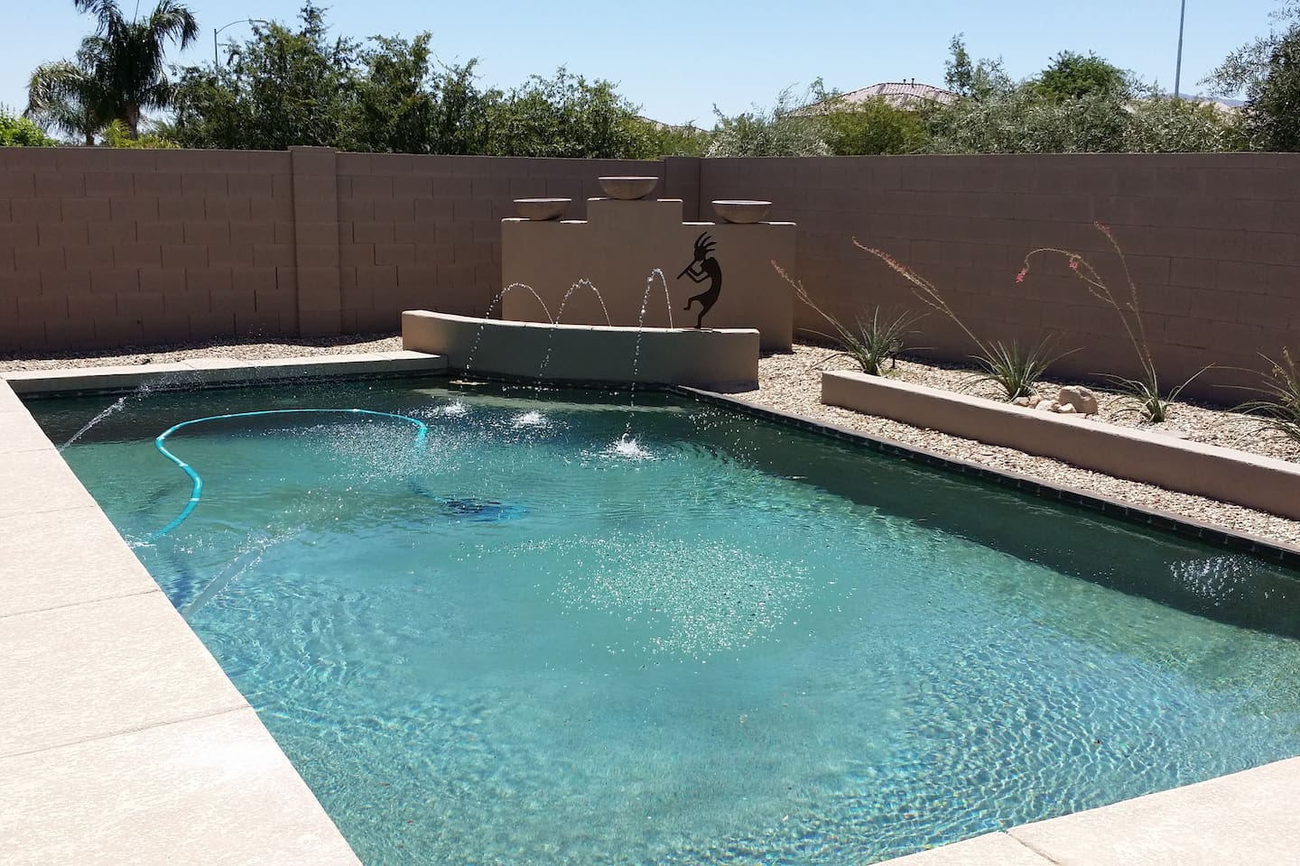 25 x 14 ft pool 5 ft 6 in deep on far side with arching jets and pool heat is optional. Shallow end 3 ft deep