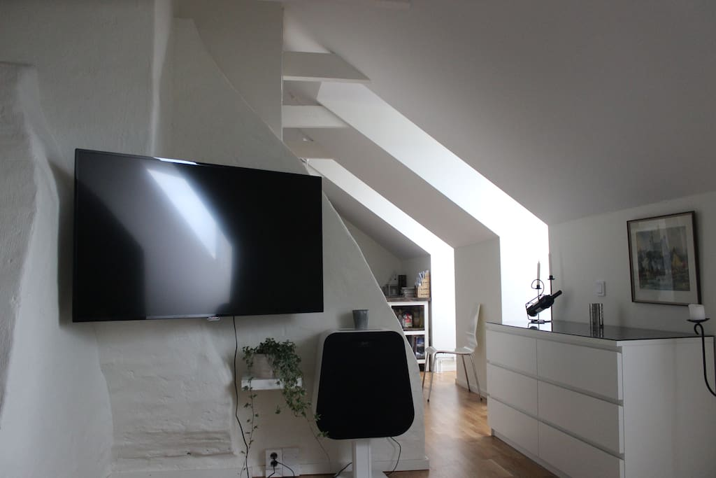 """View from sofa. The flat has a """"55 wall-mounted TV and a rather powerful sound-system if you wish to stay in for a movie night."""