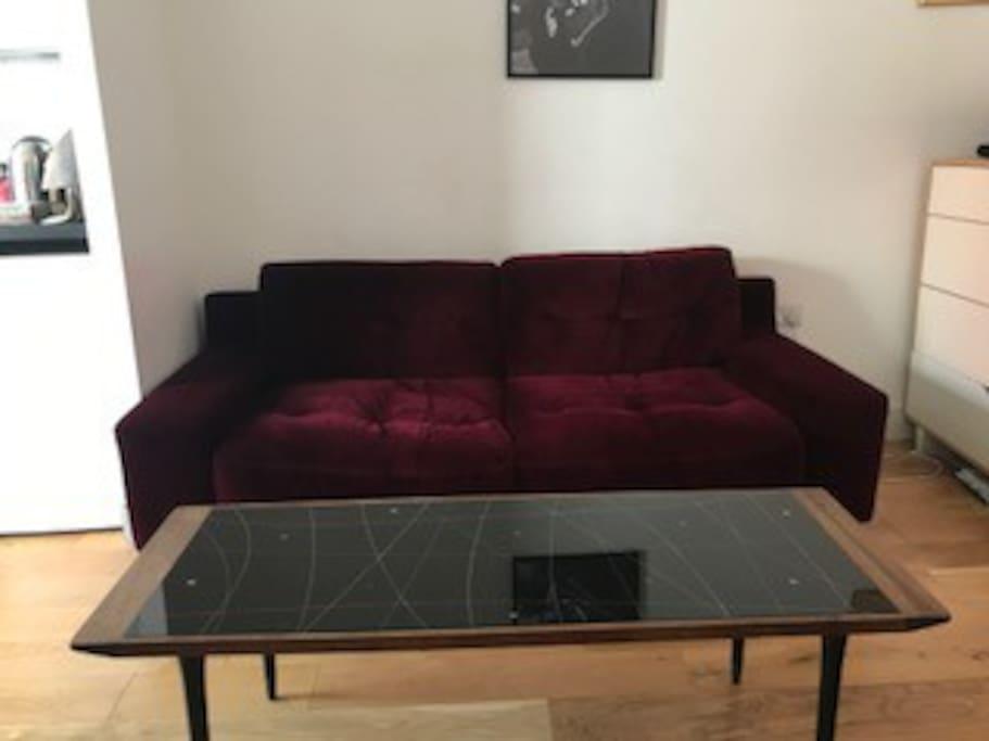 Living area, sofa and original Art Deco table