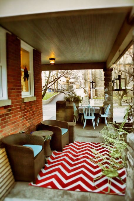 Beautiful wrap around porch with side patio. The garden creates a tiny oasis.