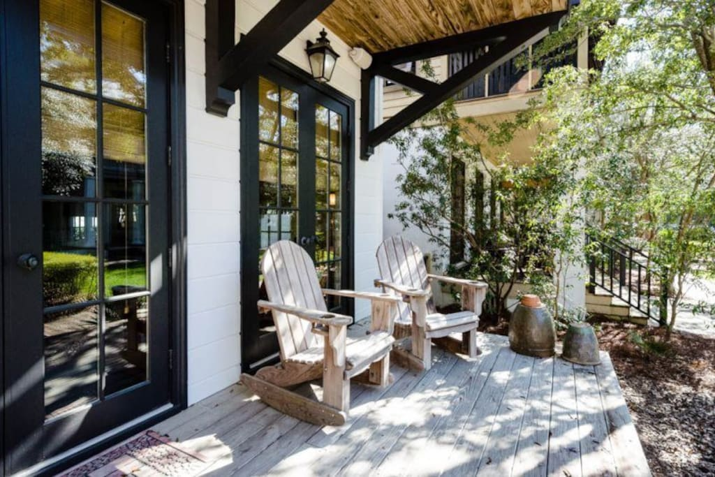 Wooden back deck, shaded by oak trees