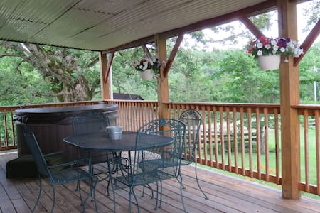 Cabin W/ Backyard Pond, Covered Deck, & Hot Tub