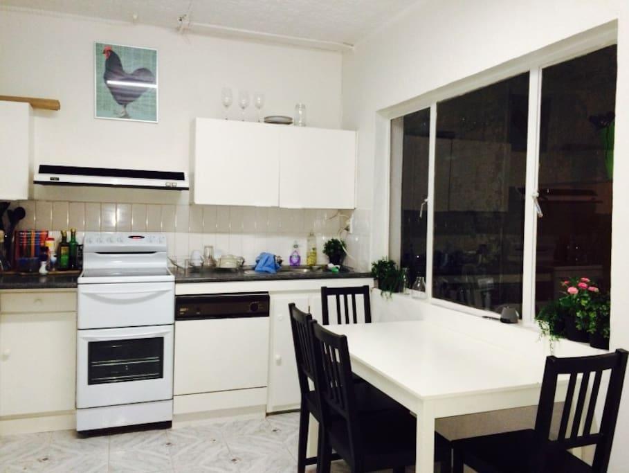 Kitchen including dishwasher and oven, microwave, fridge freezer.