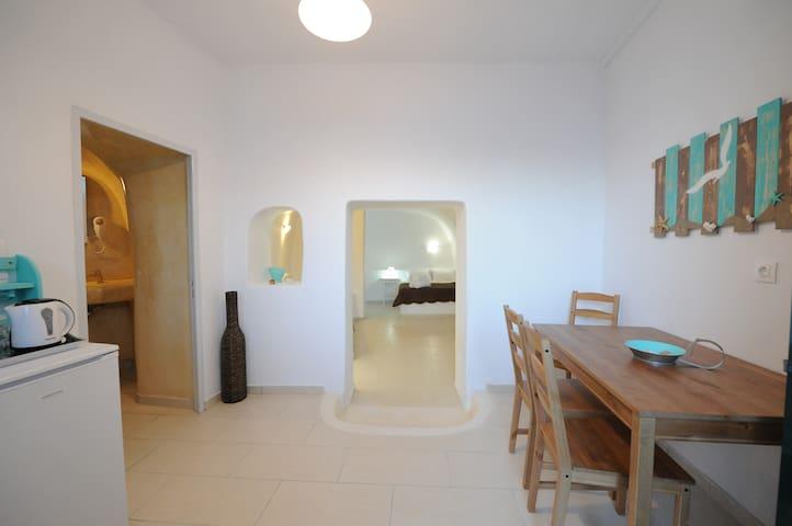 Manias Fira Residences  | Cave Apartment [36 m²]