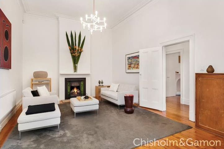 Lovely large living room. Please note that the fireplace is ornamental only (this is a photoshopped flame!!). You will be toasty warm with the hydronic heating.
