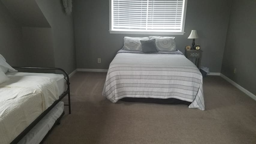 Second floor bedroom with Queen bed and daybed with trundle