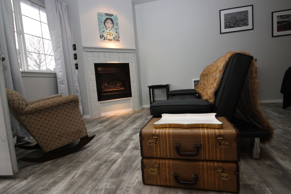 Suitcase side table and sitting area.