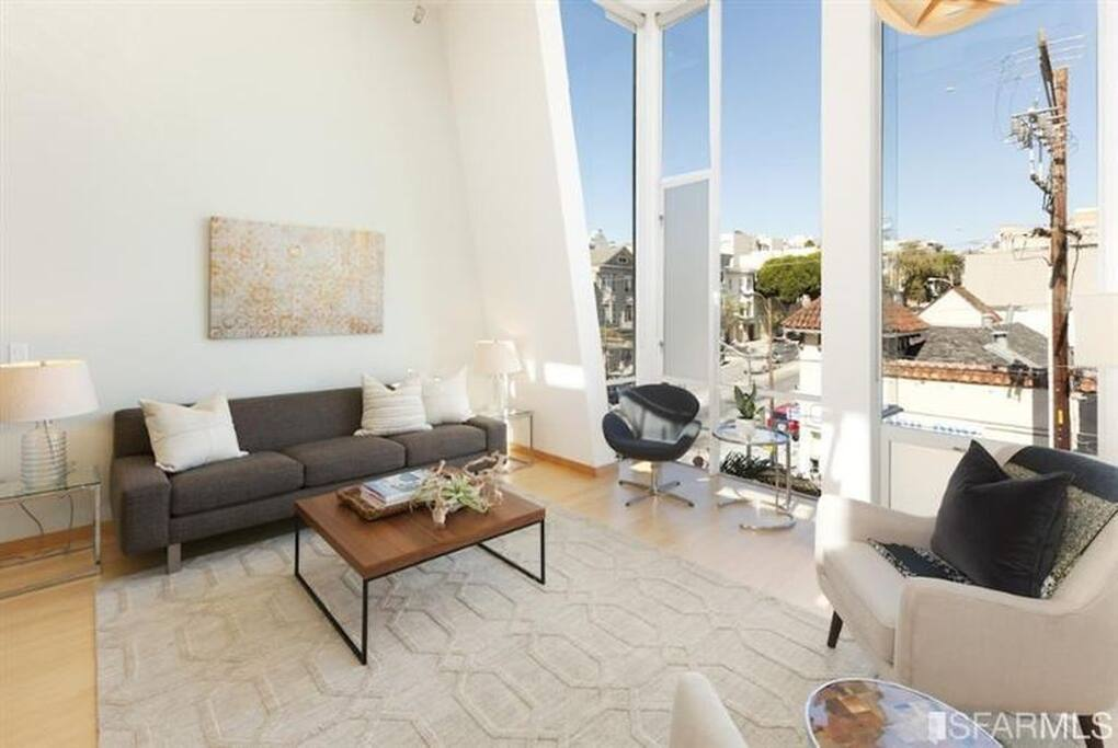 Floor to ceiling windows let all the Mission sunshine into the main living spaces